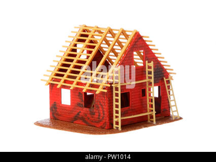 Model of a one family hose under construction isolated on white background. - Stock Photo