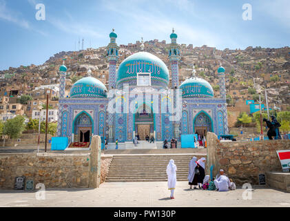 Muslim girl and women at mosque in Kabul Afghanistan city scape skyline, capital Kabul hills and mountains with houses and buildings - Stock Photo