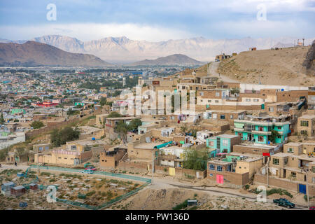 Kabul Afghanistan city scape skyline, capital Kabul hills and mountains with houses and buildings - Stock Photo