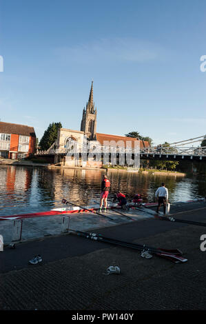 Members of the Marlow Rowing Club preparing their boats for an early morning row at Marlow in Buckinghamshire, Britain - Stock Photo