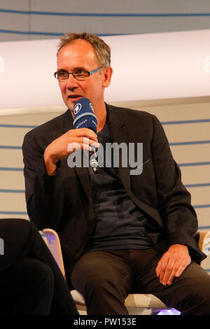 Frankfurt, Germany. 11th October 2018. German author Volker Kutscher speaks at a talk at the Frankfurt Book Fair. The 70th Frankfurt Book Fair 2018 is the world largest book fair with over 7,000 exhibitors and over 250,000 expected visitors. It is open from the 10th to the 14th October with the last two days being open to the general public. - Stock Photo