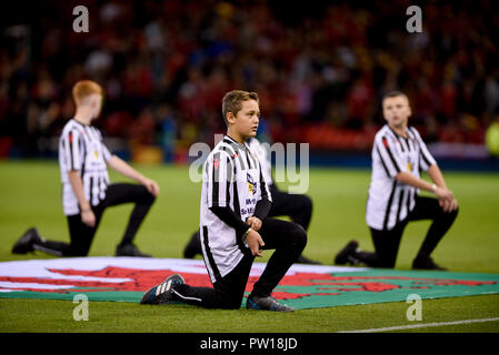 Cardiff, UK. 11th Oct 2018. Wales v Spain, International Football Friendly, National Stadium of Wales, 11/10/18: Mascots Credit: Andrew Dowling/Influential Photography/Alamy Live News - Stock Photo