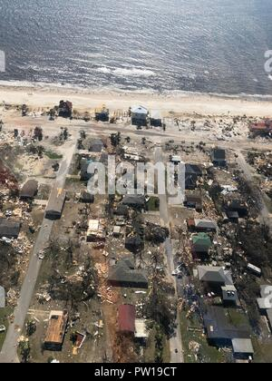 Florida, USA. 11th Oct 2018. Near total destruction to the coastal community of Mexico Beach after taking a direct hit from Hurricane Michael as the storm left a swath of destruction across the Panhandle region of Florida area October 11, 2018 in Mexico Beach, Florida. The Category 4 monster storm killed at least 6 people ad left behind catastrophic damage along northwestern Florida. Credit: Planetpix/Alamy Live News - Stock Photo
