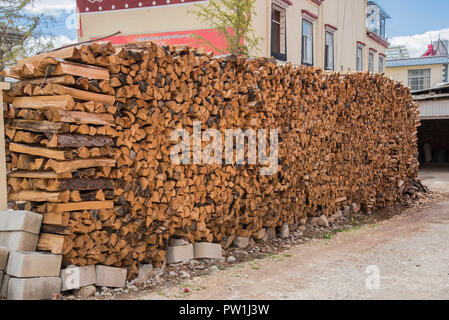 A huge pile of chopped logs ready for winter fuel.China - Stock Photo
