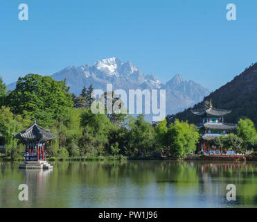 Looking across the Black Dragon Pool towards the Jade Dragon Snow Mountains of South West China Kunming. - Stock Photo