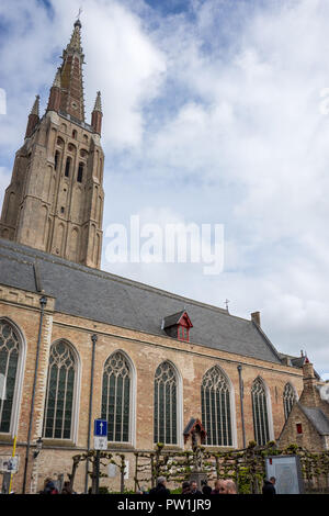 The Tower of the Church of our lady in Brugge, Belgium, Europe with a blue sky - Stock Photo