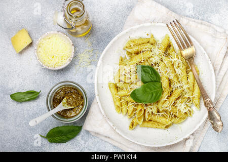 Penne pasta with pesto sauce, Parmesan cheese, olive oil and Basil. Delicious traditional dinner or lunch in Mediterranean (italian) style. Selective  - Stock Photo
