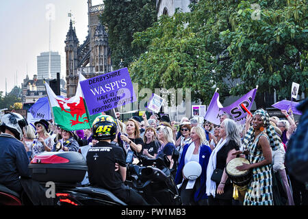 London, Women Against State Pension Inequality group campaign. Protesters block road outside Parliament. - Stock Photo