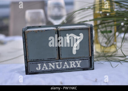 Wood blocks in box with date, day and month 7 January. Wooden blocks calenda - Stock Photo