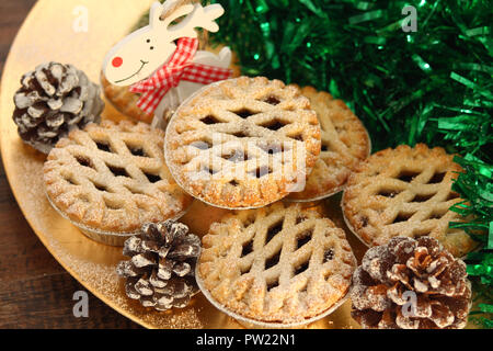 Christmas mince pies on a wooden background - Stock Photo