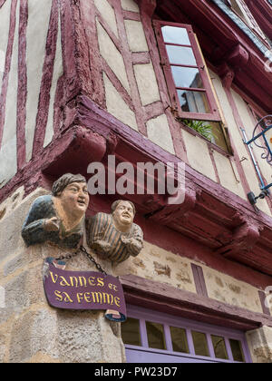 'Vannes et sa Femme' statue (Vannes and his wife) a 16th Century polychrome stone panel on the facade of a half-timbered house Vannes Brittany France - Stock Photo