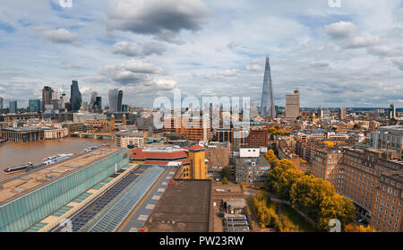 Panoramic aerial view with the Shard, skyscrapers of the City of London and London skyline on a gloomy overcast day in Autumn, toned image - Stock Photo