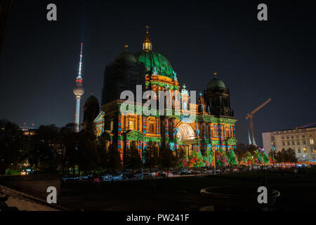 Berlin, Germany - october 2018: Illuminated landmark ( Berlin Cathedral / Berliner Dom) at night during Berlin leuchtet a.k.a. Festival of Lights - Stock Photo