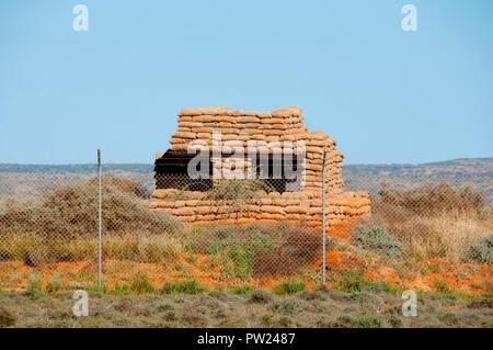 Old Fenced Military Sandbag Bunker - Stock Photo