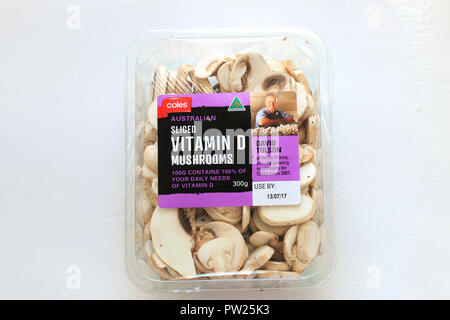 Close up of Sliced Agaricus bisporus or known as White Button Mushrooms against wooden background - Stock Photo