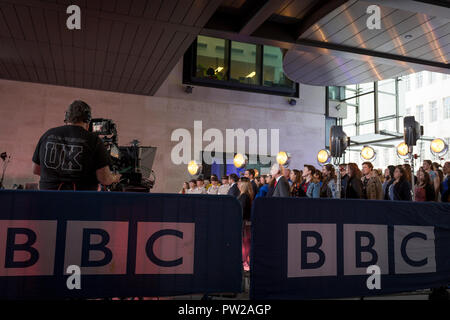 A BBC cameraman operates his equipment during a rehearsal for an outside broadcast for the One Show at Broadcasting House, on 4th October 2018, in London, England. - Stock Photo