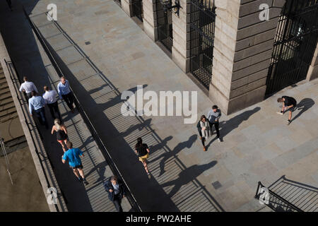 An aerial view of Londoners walking in the shadows of Fishmongers Hall Wharf in the City of London, on 10th October 2018, in London, England. - Stock Photo
