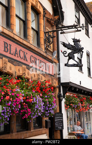 UK, Kent, Canterbury, High Street, colourful floral display outside Black Griffin pub with unusual pub sign - Stock Photo