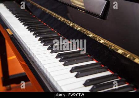 new modern piano keyboard indoor with daylight closeup - Stock Photo