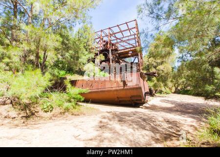 Old Tin Dredge on Nettle Creek, Innot Hot Springs, Queensland, Australia - Stock Photo