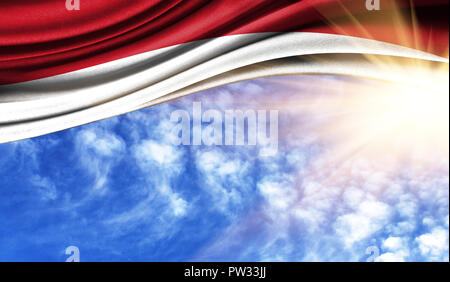 the flag of Indonesia in the rays of the summer sun, in the sky, photography has a good place for your text. - Stock Photo