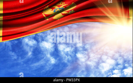 the flag of Montenegro in the rays of the summer sun, in the sky, photography has a good place for your text. - Stock Photo