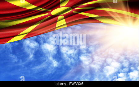 the flag of Macedonia in the rays of the summer sun, in the sky, photography has a good place for your text. - Stock Photo
