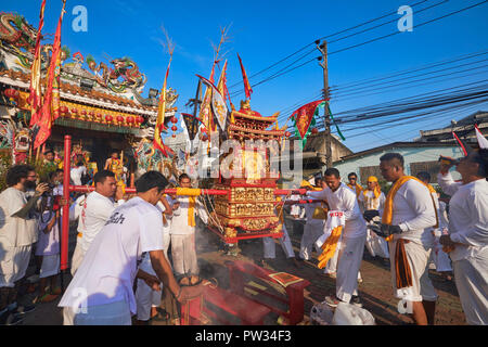 A street procession during the annual Vegetarian Festival in Phuket, Thailand, here starting out at the Chinese temple in Sapam north of Phuket Town - Stock Photo
