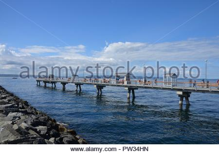 Quayside of fishing port in Edmonds, Washington state, Seattle metropolitan area, State ferry system, blue sky, cloudy, Pacific ocean, September sunny - Stock Photo