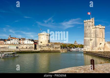 St Nicolas Tower (Tour Saint Nicolas) and The Chain Tower (Tour de la Chaine) at the entrance to the ancient port of La Rochelle, Charente Maritime,   - Stock Photo