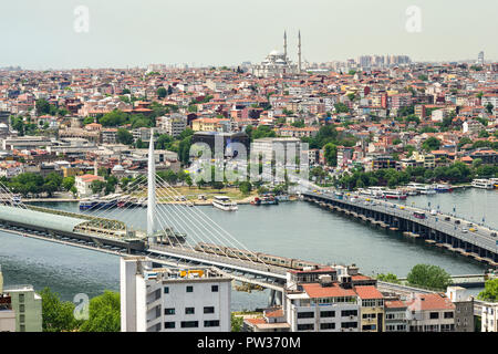 The view from Galata Tower across Beyoglu to the Golden Horn with metro bridge and the city on a sunny day, Istanbul, Turkey - Stock Photo