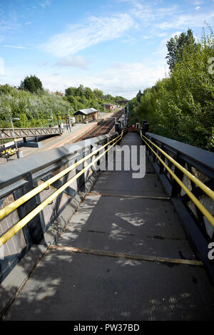 access ramp down to hunts cross train railway station Liverpool Merseyside England UK - Stock Photo