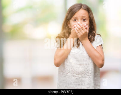 Brunette hispanic girl shocked covering mouth with hands for mistake. Secret concept. - Stock Photo