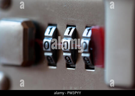 Combination padlock close up with chrome numbers. Mechanical combination lock, counter. Selective focus - Stock Photo