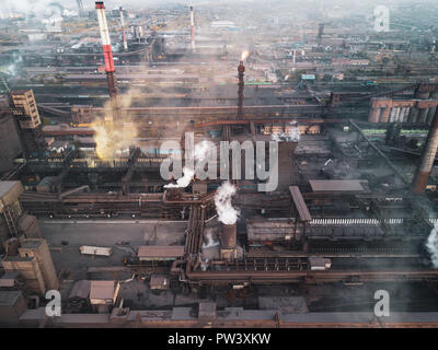 View point of smoking chimney with yellow white black colors; burning fire and smoke coming out of factory pipes; industrial zone with dirty air and f - Stock Photo