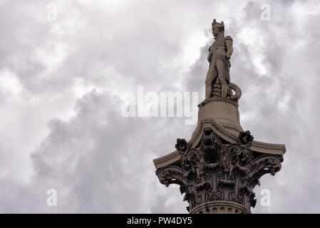 Low angle view of Nelson's Column against cloudy sky - Stock Photo