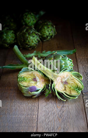 Globe artichoke cut in half showing a cross section of inside. - Stock Photo