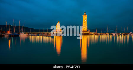 View of the harbor entrance and lighthouse in Lindau on Lake Constance. - Stock Photo