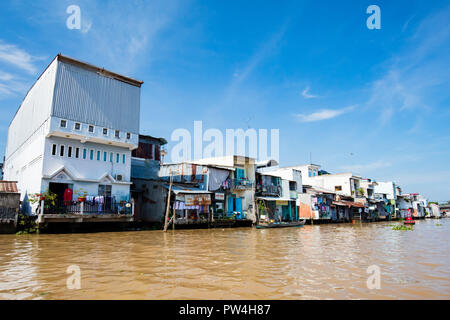 Typical housing on the banks of the Mekong River near Cai Be in Mekong Delta, Vietnam