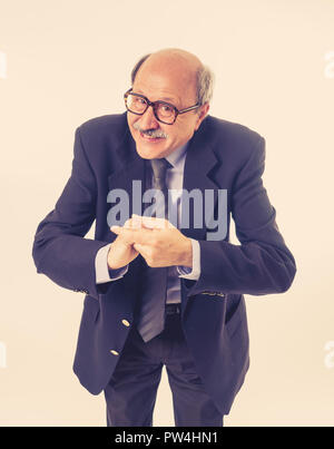 Full body portrait of a cheerful delighted senior businessman rubbing his hands in happiness at last day of work and future retirement lifestyle isola - Stock Photo