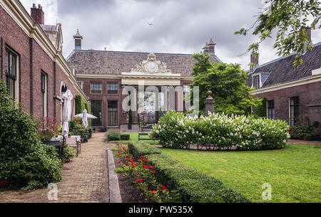 The entrance of the almshouse the green garden in the old center of Haarlem in the Netherlands - Stock Photo