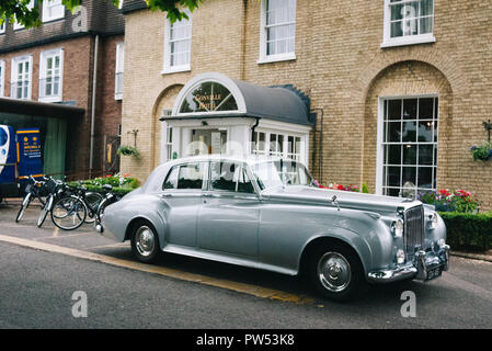 Gonville Hotel in Cambridge, UK. Front entrance with a rare 1962 Rolls Royce Silver Cloud II S.C.T 100 in front of the door - Stock Photo