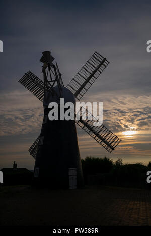 Ellis Mill, part of the UK's industrial heritage, silhouetted against evening sunlight, Lincoln Edge, Lincoln, UK - Stock Photo