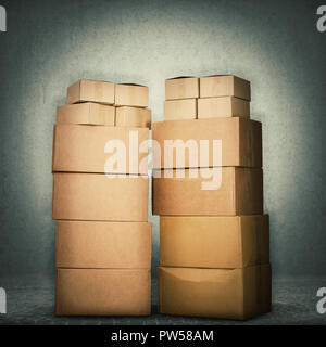 Stack of cardboard boxes full length isolated over grey wall concrete background. Delivery cargo warehouse storage concept. - Stock Photo