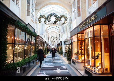 LONDON, UK - NOV 21: people stroll in the Burlington Arcade in London on November 21, 2013. It is one of the best-known London shopping arcades at Chr - Stock Photo