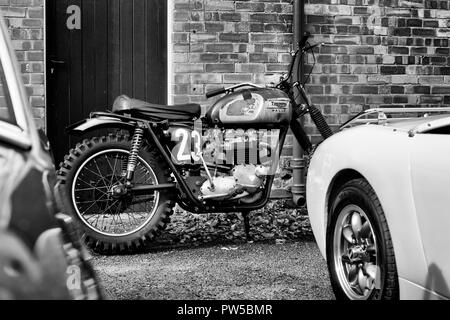 Triumph motorcycle at the Autumn sunday scramble event at Bicester Heritage Centre. Oxfordshire, England. Black and white - Stock Photo