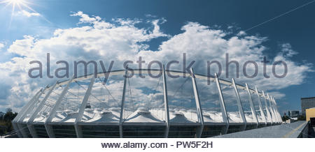 Ukraine, Kiev - June 15, 2018: European Olympic stadium in Kyiv, panoramic view NSC of modern outside facade. HDR cityscape. Blue sky with clouds - Stock Photo