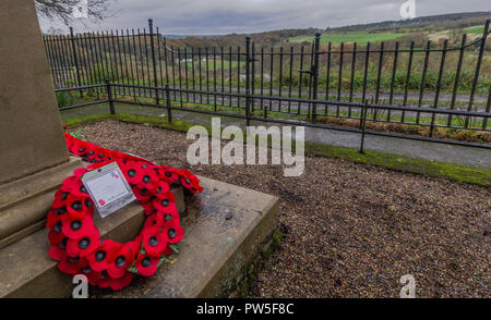 Poppy wreaths have been laid at the base of Tong Park war Memorial in Baildon, Yorkshire. - Stock Photo