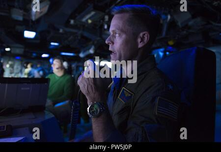 Caribbean Sea (Sept. 19, 2017) Commander, Expeditionary Strike Group 2, Rear Admiral Jeffrey Hughes addresses the crew of the amphibious assault ship USS Wasp (LHD 1). Wasp is currently assisting residents of the Caribbean Islands in the wake of Hurricane Irma, and is also preparing to assist once Hurricane Maria makes landfall. - Stock Photo
