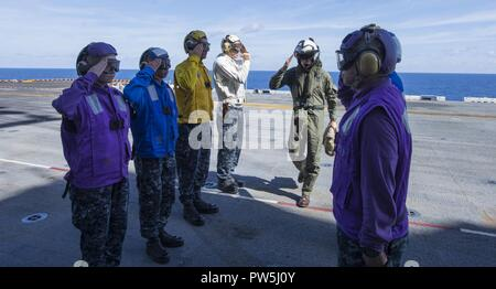 Caribbean Sea (Sept. 19, 2017) Commander, Expeditionary Strike Group 2, Rear Admiral Jeffrey Hughes salutes sideboys as he arrives aboard the amphibious assault ship USS Wasp (LHD 1). Wasp is currently assisting residents of the Caribbean Islands in the wake of Hurricane Irma, and is also preparing to assist once Hurricane Maria makes landfall. - Stock Photo